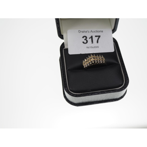 317 - 10ct gold ring with 3 rows of diamonds, size N1/2, 3 grams...