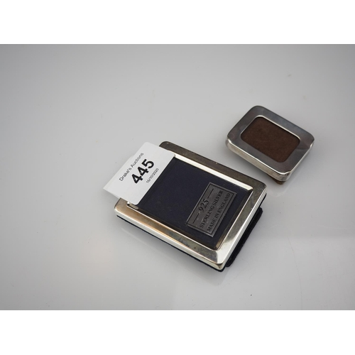 445 - Two small silver photo frames, 4.3cm & 6.5cm high respectively...