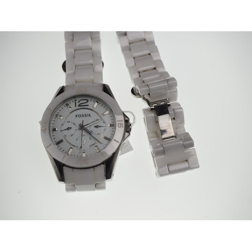 818 - Fossil white ceramic & stainless steel wristwatch with three subsidiary dials, with additional white...