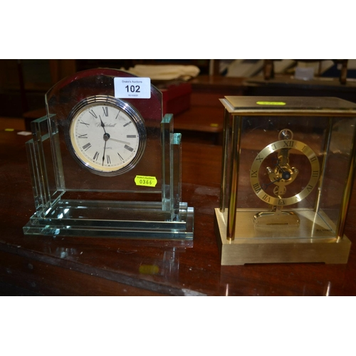 102 - 2 quartz clocks inc. skeleton style...