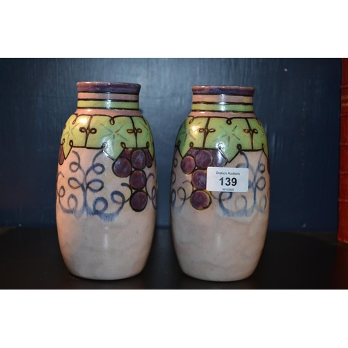139 - Royal Doulton Lambeth Florrie Jones grapes & vine vases in an Arts & Crafts style, stamped 7942 to b...