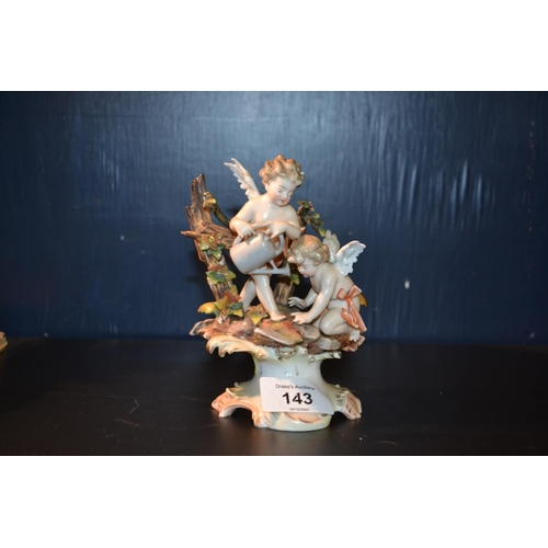 143 - Antique continental ceramic figure of cherubs...