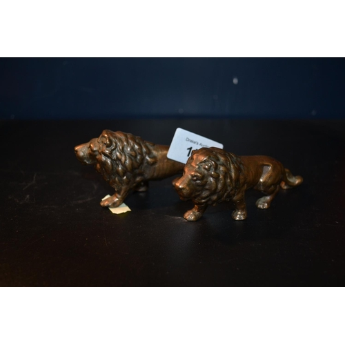 151 - Pair of bronzed lions...