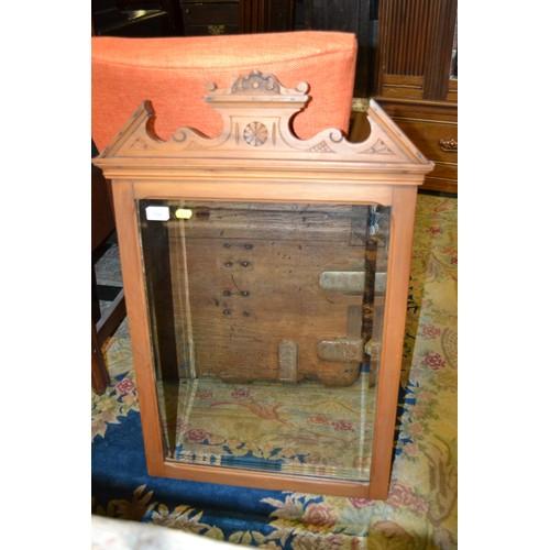 109 - Light oak framed bevelled mirror from a dressing table. 57 x 86 cm....