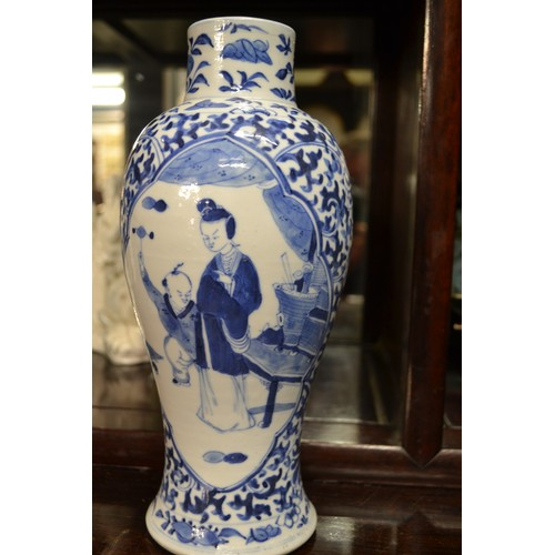 171 - Blue and white oriental vase/urn with lid and characters to base....