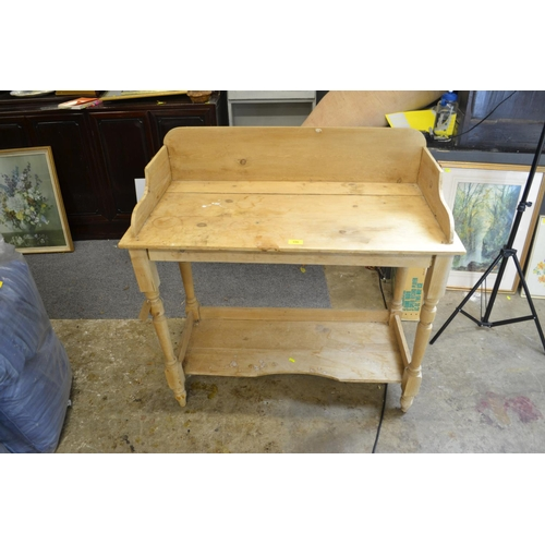 11 - Stripped pine wash stand. Front legs appear to be shorter than back, so is on a slight lean
