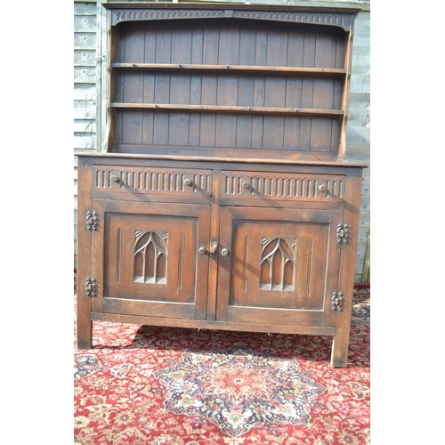 12 - Oak open topped dresser with carved panels to cupboard W128 D48 H168cm