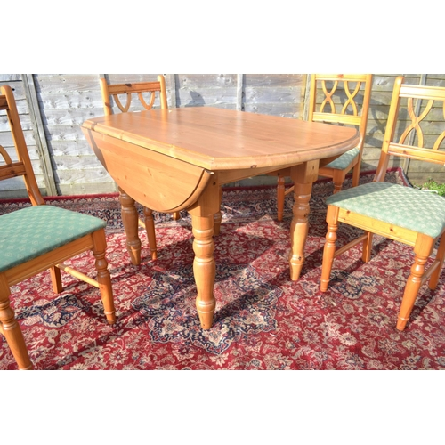 4 - Pine drop-sided table with 4 chairs. Dia 128, collapsed width 82cm