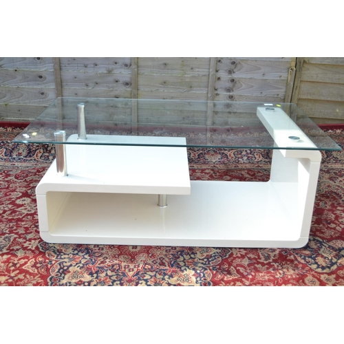 35 - Glass topped modernist coffee table, 110cm wide, 65cm deep, 43cm high