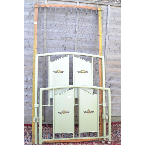 47 - Metal framed single bed with details to head and feet