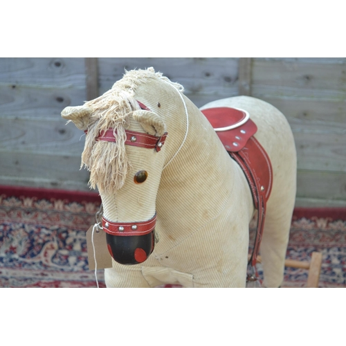 51 - Rocking Horse in Corduroy missing tail and needs attention as some sharp metal protrusions on head