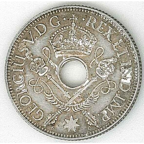 34 - Coins; New Guinea; 1935 One Shilling VF/EF. Krause 5, cat.$5½/$6½....