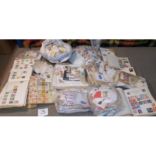 3 - Collections and Mixed Lots; a large box (some damp damage) of on/off-paper stamps, three albums/stoc...