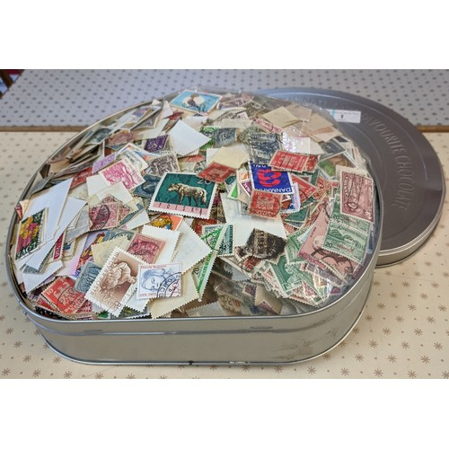 1 - Collections; biscuit tin crammed with c.700g of world off-paper stamps, little or no UK seen. (1,000...