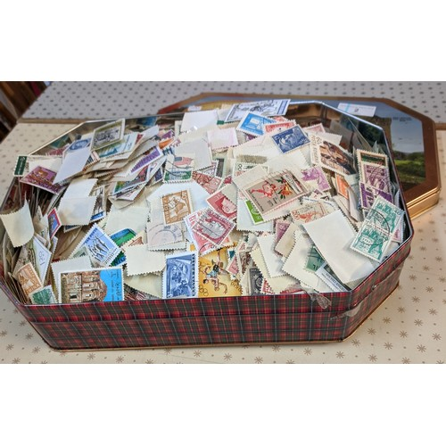 2 - Collections; shortbread tin well-filled with c.500+g of world off-paper stamps, little or no UK seen...