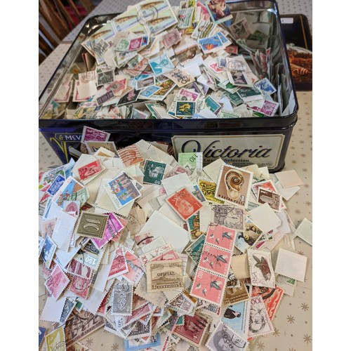 3 - Collections; biscuit tin well-filled with c.500g of world off-paper stamps, little or no UK seen. (1...