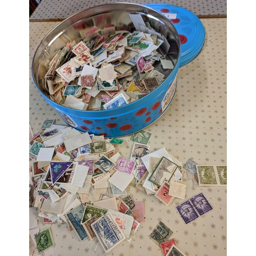 5 - Collections; sweetie tin with c.150g of world off-paper stamps, little or no UK seen. (1,000s)