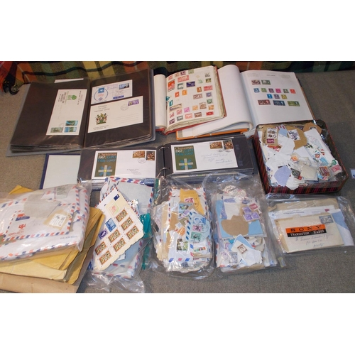 13 - Mixed Lots; carton with general world in two albums, folder of FDCs of Malaŵi, Rhodesia etc., loose ...