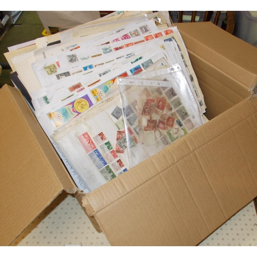 28 - Mixed Lots; box filled with stamps on pages. Some of this is low grade (stamps stuck to pages, etc.)...