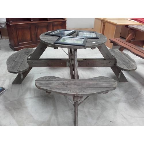 18 - Large circular picnic table...