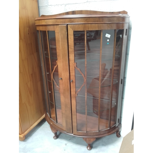 55 - Bow glass fronted display cabinet with two keys...