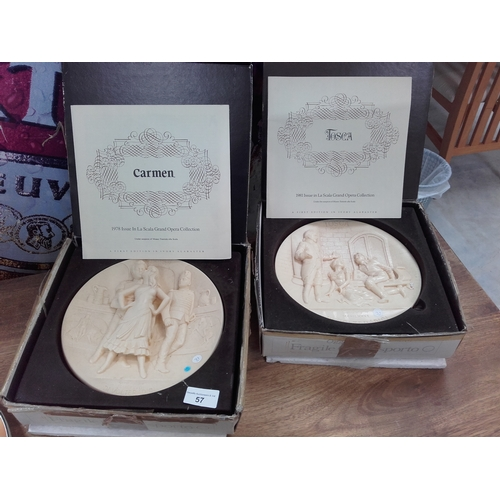57 - 2 boxed alabaster carved Tosca & Carmen wall hangings...