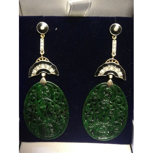11 - Pair of silver & gold drop earrings set with large oval patterned jade, diamonds & black enamel...