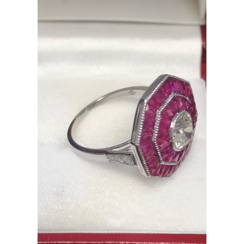 13 - Fine quality octagonal shaped platinum ruby & diamond dress ring set with a central old cut diamond,...