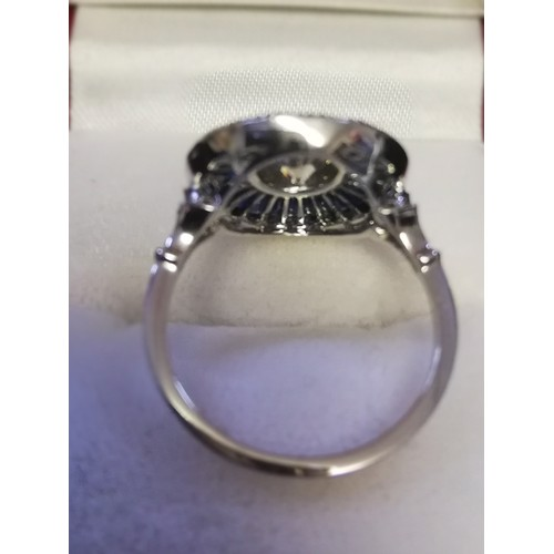 14 - Large platinum target style ring set with central diamond and calibre cut sapphires -centre diamond ...