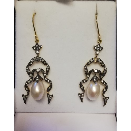 15 - Pair of ornate drop earrings set with diamonds and a suspended pearl...