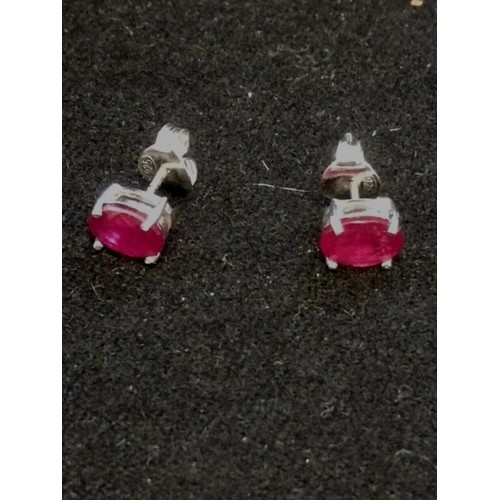 26 - Pair of silver ruby studs (treated)...