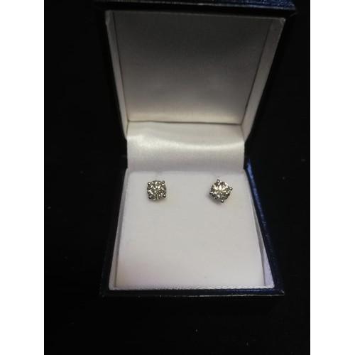 27 - Pair 18ct white gold diamond studs -approx diamond weight 1.41ct...