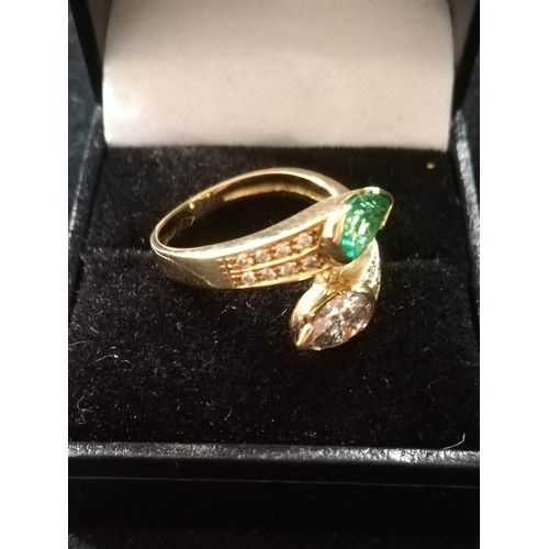 31 - Emerald and Diamond pear shaped stones crossover ring...