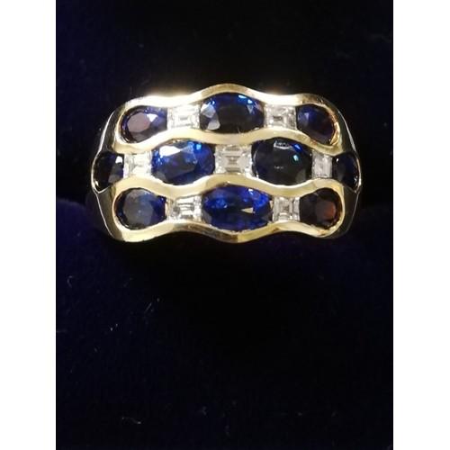 32 - Sapphire and Diamond 18ct 3 row ring...