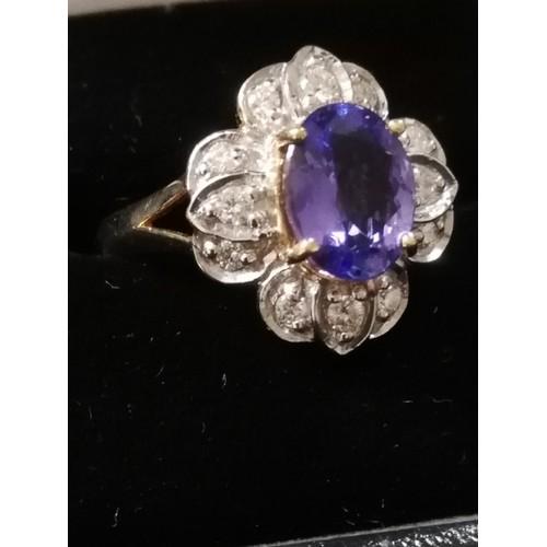 33 - 18ct Tanzanite and Diamond ring...