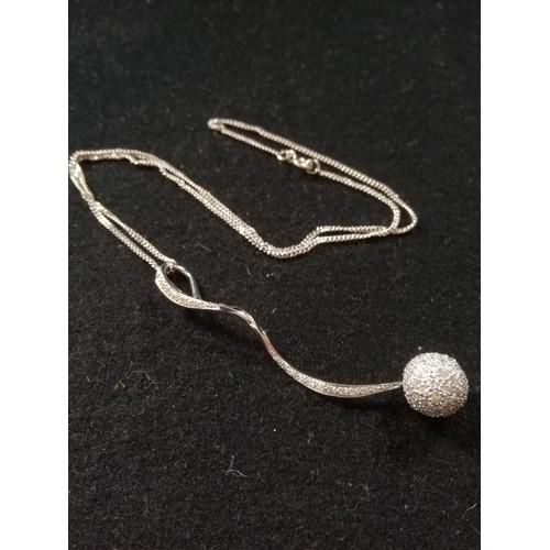 34 - 18ct Diamond ball pendant and chain...