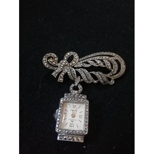 49 - Ladies '800' silver marcasite brooch / watch by Bucherer...