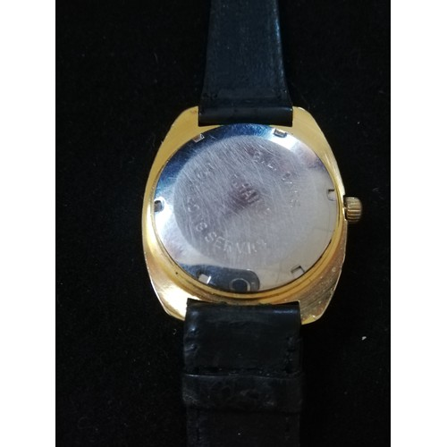 51 - Garrard gold plated wristwatch with automatic movement in worn condition with inscription to back...
