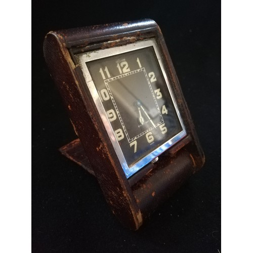 55 - Le Coultre leather cased 8 day travel clock in worn condition & in running order...