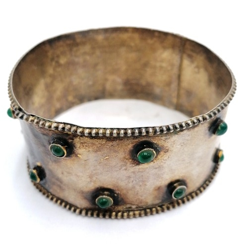 218 - Ethnic, Tribal white metal dowry belt a/f T/w a green stone set white metal bangle and another...