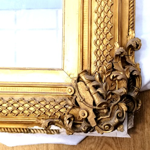 620 - Antique gilt framed mirror with nautical themed decoration (some losses, and some of the detached pi...