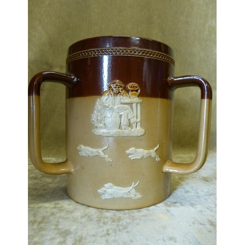 105 - A Royal Doulton Glazed Stoneware 3-Handled Loving Cup on brown ground having raised hunting scene de...