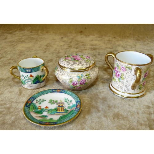 125 - A Crown Staffordshire Miniature 3-Handle Loving Cup having multicoloured floral, leaf and gilt decor...