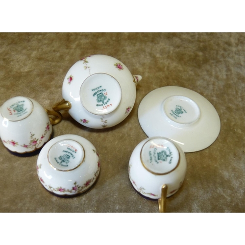 126 - A Miniature Coalport Bachelors Tea Service on white and blue ground with coloured rose, leaf and gil...