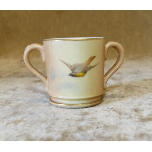 133 - A Royal Worcester Blush 2-Handled Miniature Cup having hand painted bird decoration, 4cm high...