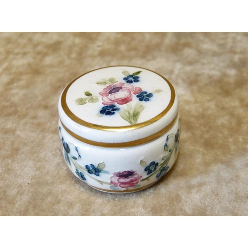 134 - A Macintyre Moorcroft Miniature Lidded Pill Box on white ground with multicoloured ribbon swag, flor...