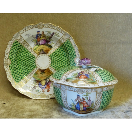 139 - A Similar Continental Oval Scalloped Lidded Box with matching plate on white and green ground with m...