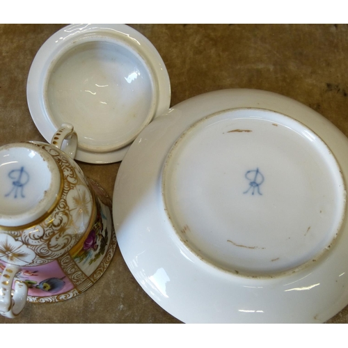 140 - A Meissen Dresden 2-Handled Lidded Cup with saucer having pierced surrounds on white and pink ground...