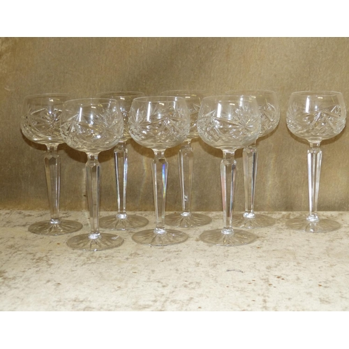 160 - A Set of 8 Cut Glass Hock Glasses on hexagonal stems with round bases...