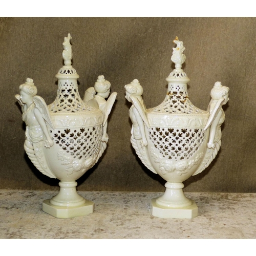 165 - A Pair of Leeds Pottery Creamware Urn Shaped Lidded Pots having winged figure handles on square base...
